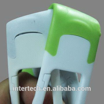 Green and white elastomer plastics molding